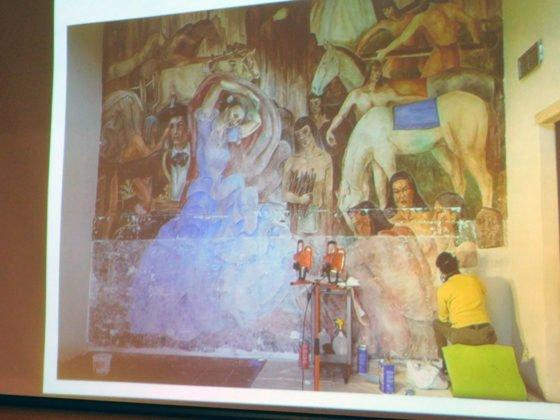 Art restorer working on fresco