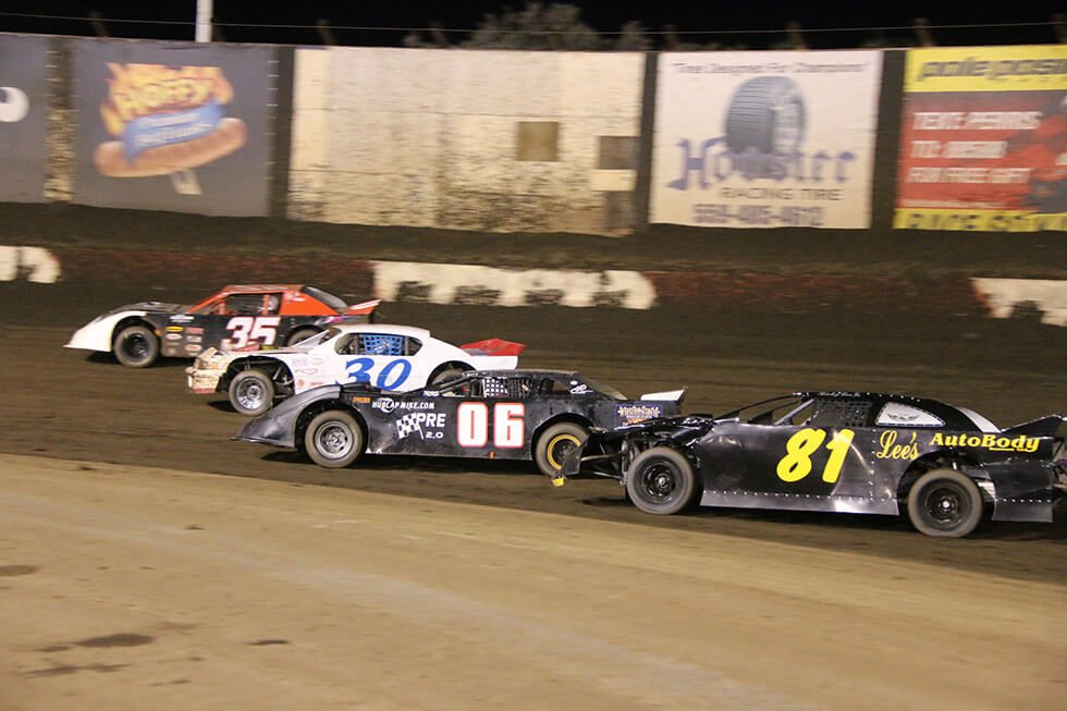 Cars racing at PASSCAR Super Stocks at the Perris Auto Speedway
