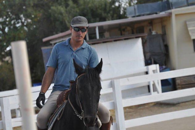 James Farnum riding a horse